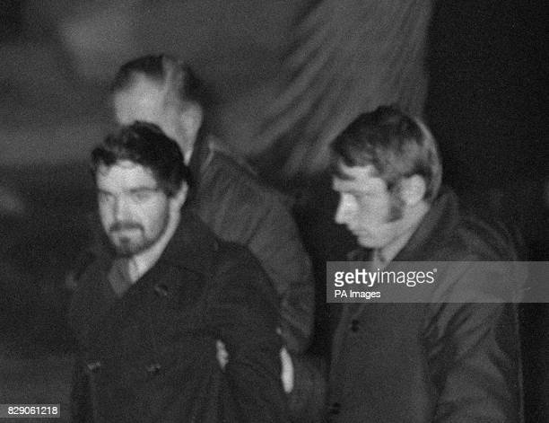 Eddie Gallagher escorted from the Monasterevin council house where he and Marian Coyle surrendered to police without violence after an 18day siege...