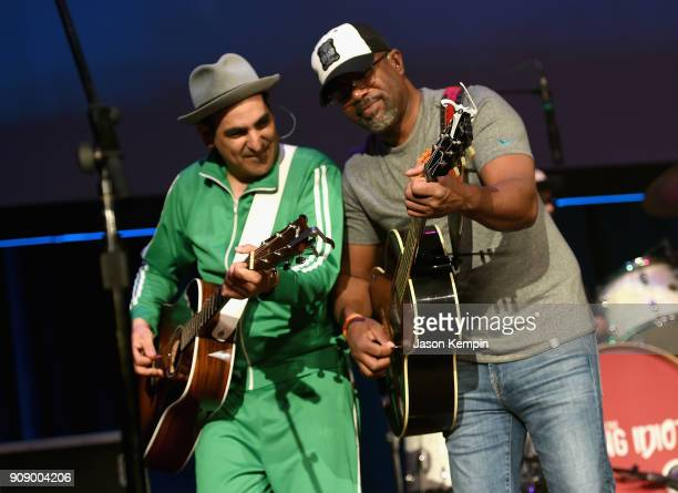 Eddie Garcia and Darius Rucker perform onstage during the Bobby Bones The Raging Idiots' Million Dollar Show for St Jude at the Ryman Auditorium on...
