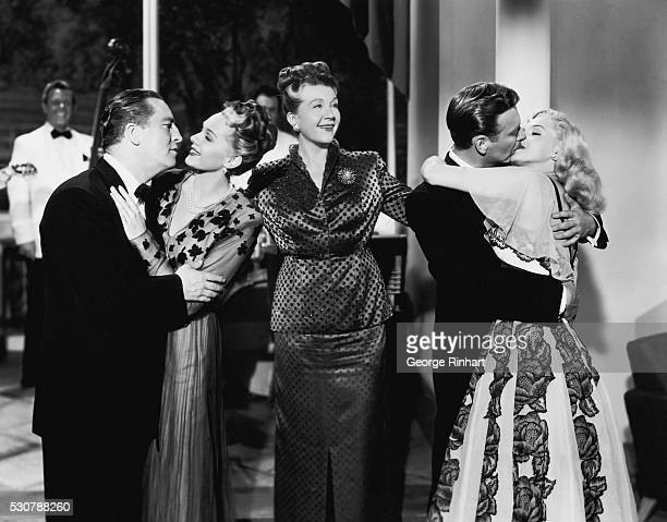 Eddie Garr Adele Jergens Nana Bryant Rand Brooks and Marilyn Monroe in a scene from the Columbia production 'Ladies of the Chorus'