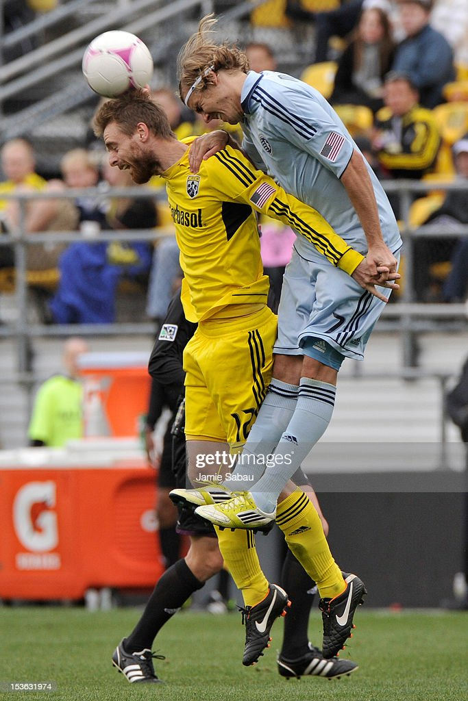 Eddie Gaven #12 of the Columbus Crew and Chance Myers #7 of Sporting Kansas City battle for control of the ball on October 7, 2012 at Crew Stadium in Columbus, Ohio.