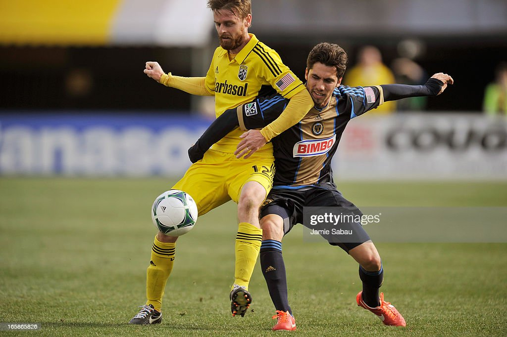 Eddie Gaven #12 of the Columbus Crew and Gabriel Farfan #15 of Philadelphia Union battle for control of the ball in the first half on April 6, 2013 at Crew Stadium in Columbus, Ohio. Columbus and Philadelphia played to a 1-1 tie.
