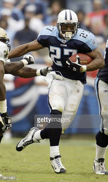 Eddie George of the Tennessee Titans breaks free from the New Orleans Saints defense on September 21 2003 at The Coliseum in Nashville Tennessee The...