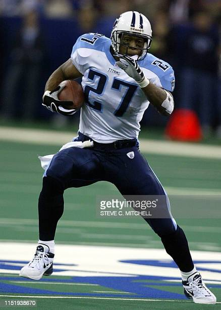 Eddie George of the Tennessee Titans carries the ball in the first half of the Titans and Indianapolis Colts game 03 November 2002 at the RCA Dome in...