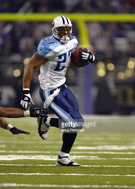 Eddie George of the Tennessee Titans runs the football during the game against the Baltimore Ravens in the NFL AFC Wild Card game on January 3 2004...