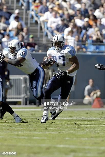 Eddie George of the Tennessee Titans runs with the ball during a game against the Carolina Panthers on October 19 2003 at Ericsson Stadium in...