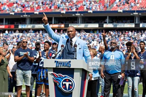 Eddie George of the Tennessee Titans speaks during the halftime presentation to retire his number during a game against the Indianapolis Colts at...
