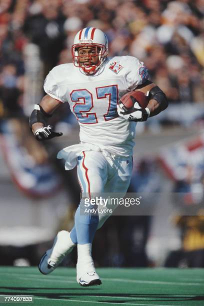 Eddie George Running Back for the Tennessee Titans runs the ball during the American Football Conference Central game against the Minnesota Vikings...