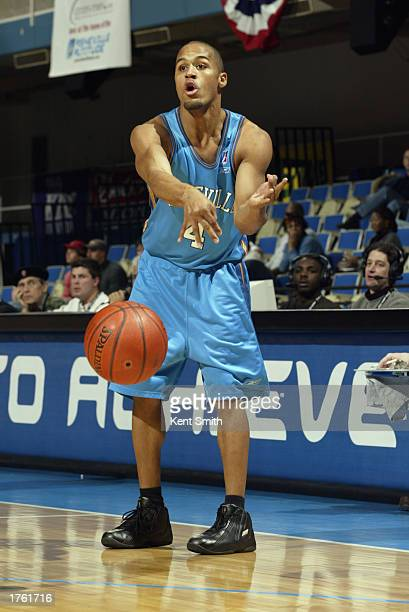Eddie Gill of the Asheville Altitude passes against the Columbus Riverdragons during the game at the Asheville Civic Center on January 24 2003 in...