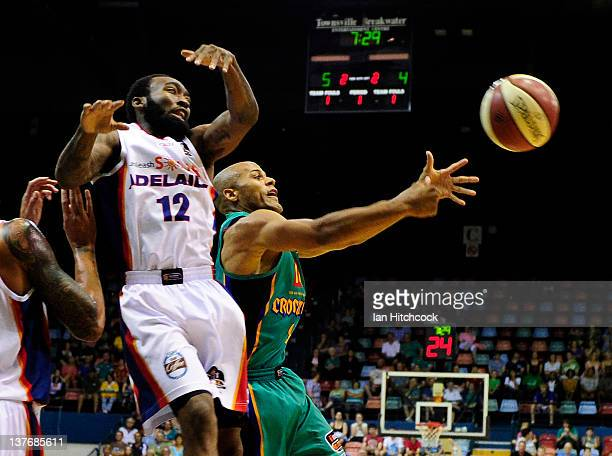Eddie Gill of the Crocodiles contests the ball with Chris Warren of the 36ers during the round 17 NBL match between the Townsville Crocodiles and the...