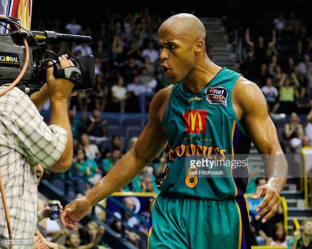 Eddie Gill of the Crocodiles yells into a T.V camera during the round two NBL match between the Townsville Crocodiles and the Cairns Taipans at...