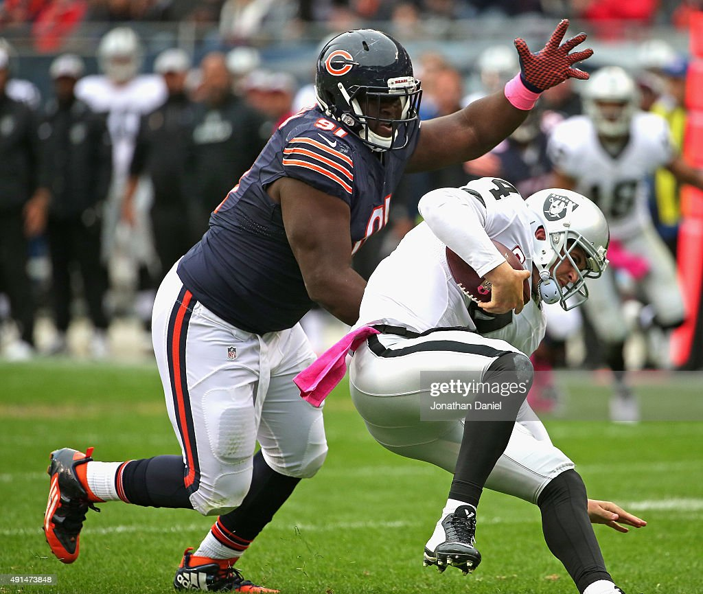 Eddie Goldman #91 of the Chicago Bears sacks Derek Carr #4 of the Oakland Raiders at Soldier Field on October 4, 2015 in Chicago, Illinois. The Bears defeated the Raiders 22-20.