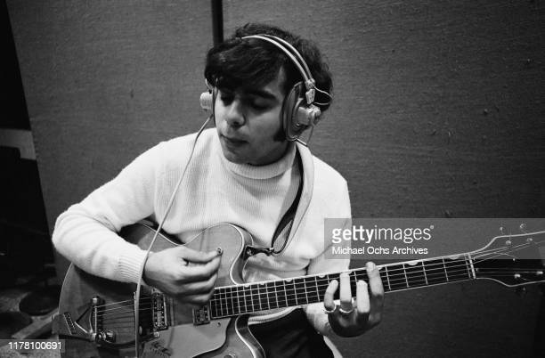 Eddie Gray the guitarist of the band Tommy James and the Shondells during a recording session for their track 'Crimson and Clover' 30th October 1968