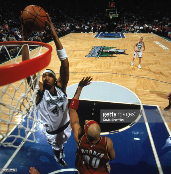 Eddie Griffin of the Minnesota Timberwolves takes the ball to the basket over Drew Gooden of the Cleveland Cavaliers during a game at Target Center...