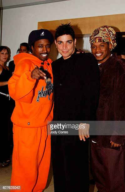 Eddie Griffith Michael DeLorenzo and MTV VJ Sway arrive at the Warner Music Group and Entertainment Weekly postGrammy party