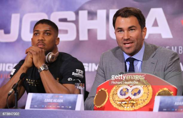 Eddie Hearn boxing promoter and Anthony Joshua speak during a press conference for his Super Heavyweight title fight against Wladamir Klitschko at...