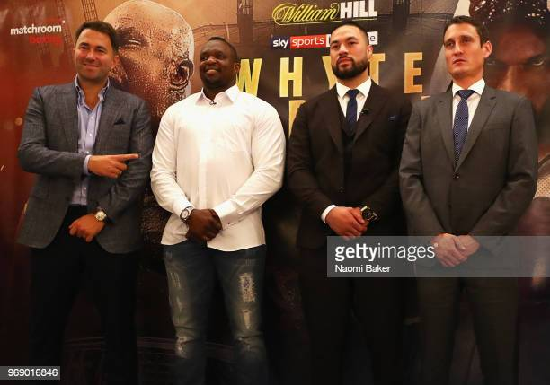Eddie Hearn Dillian Whyte Joseph Parker and David Higgins pose for photographs during the Dillian Whyte and Joseph Parker Press Conference at The...