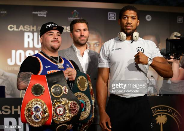 Eddie Hearn stands between Andy Ruiz Jr and Anthony Joshua during the Clash On The Dunes Press Conference at the Diriyah Season Hospitality Lounge on...