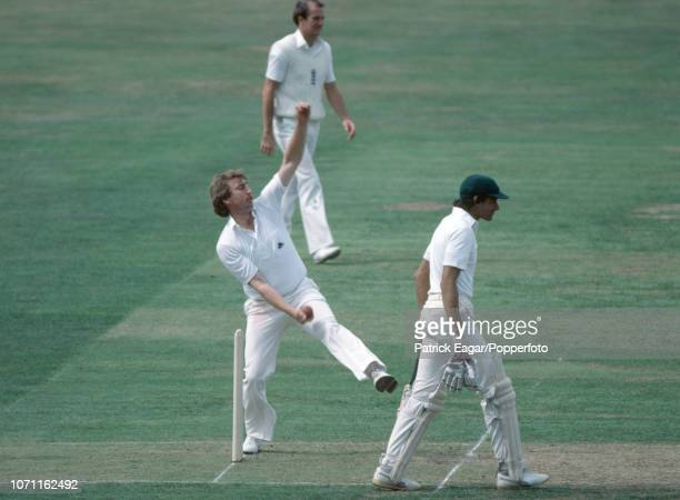 Eddie Hemmings of England bowls past Pakistan batsman Mohsin Khan during the 2nd Test match between England and Pakistan at Lord's Cricket Ground...