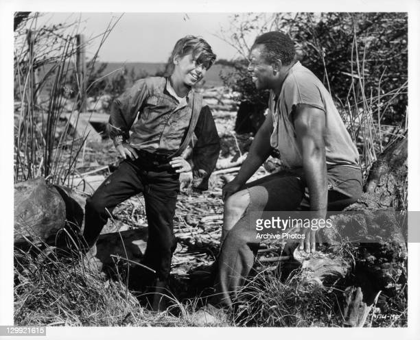 Eddie Hodges and Archie Moore are happy after eluding the slave catchers in a scene from the film 'The Adventures Of Huckleberry Finn' 1960