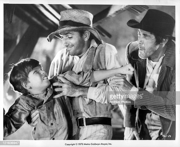 Eddie Hodges is being grabbed by Dean Stanton in a scene from the film 'Adventures of Huckleberry Finn' 1960