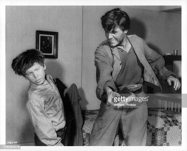 Eddie Hodges is hit by Neville Brand in a scene from the film 'The Adventures Of Huckleberry Finn' 1960