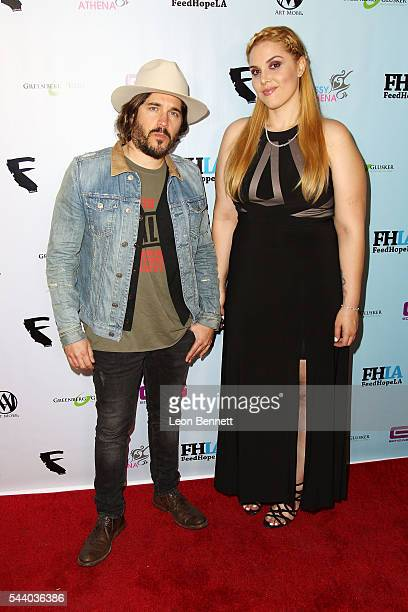 Eddie Horowitz and Photographer Cassy Athena attends the EMotion Art Show on June 30 2016 in Los Angeles California