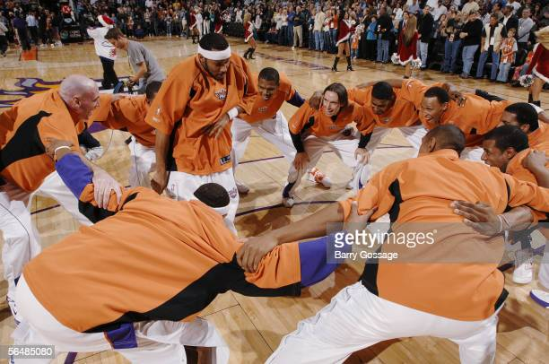 Eddie House gets the Phoenix Suns fired up during their pregame huddle in an NBA game played against the Washington Wizards on December 23 2005 at...