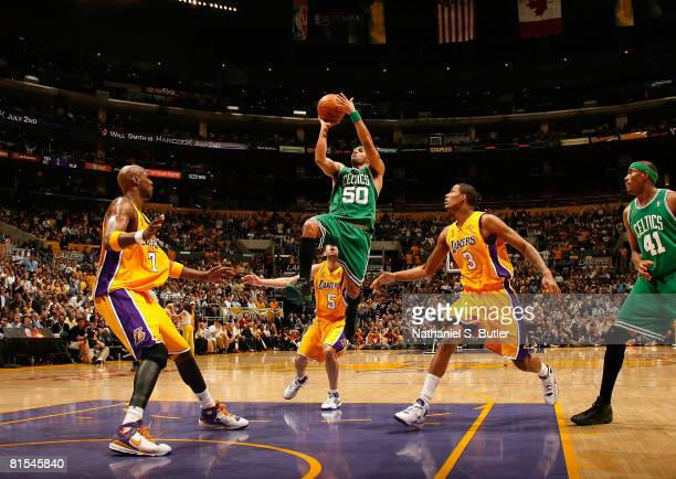 Eddie House of the Boston Celtics drives for a shot attempt against Lamar Odom and Trevor Ariza of the Los Angeles Lakers in Game Four of the 2008...