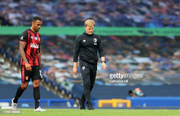 Eddie Howe Manager of AFC Bournemouth and Callum Wilson walk off dejected at the final whistle as it is confirmed Bournemouth are relegated from the...