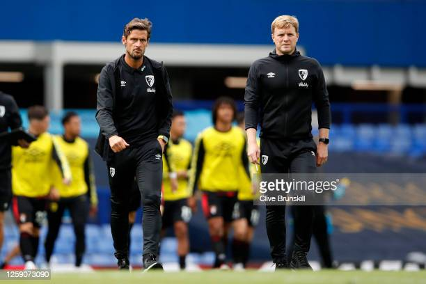 Eddie Howe Manager of AFC Bournemouth and his assistant Jason Tindall walk off at half time during the Premier League match between Everton FC and...