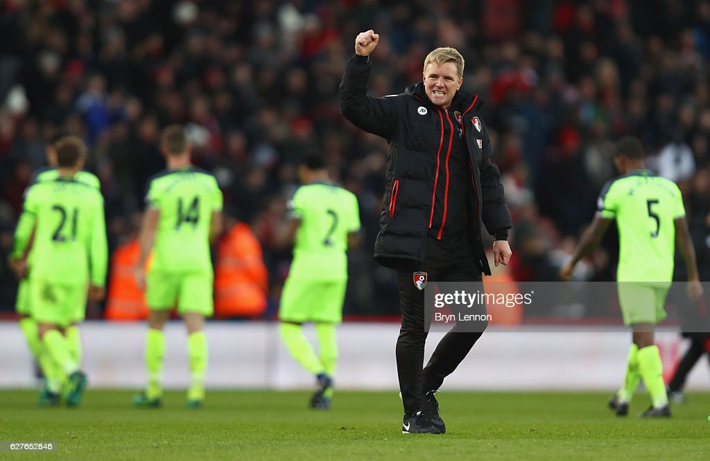 Eddie Howe manager of AFC Bournemouth celebrates victory as Liverpool players look dejected after the Premier League match between AFC Bournemouth and Liverpool at Vitality Stadium on December 4, 2016 in Bournemouth, England.