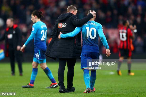 Eddie Howe Manager of AFC Bournemouth embraces Jack Wilshere of Arsenal after the Premier League match between AFC Bournemouth and Arsenal at...