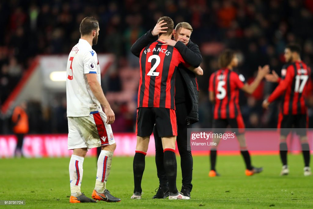 Eddie Howe, Manager of AFC Bournemouth embraces Simon Francis of AFC Bournemouth following the Premier League match between AFC Bournemouth and Stoke City at Vitality Stadium on February 3, 2018 in Bournemouth, England.