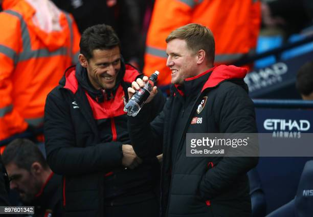 Eddie Howe Manager of AFC Bournemouth speaks to Jason Tindall AFC Bournemouth assistant manager prior to the Premier League match between Manchester...