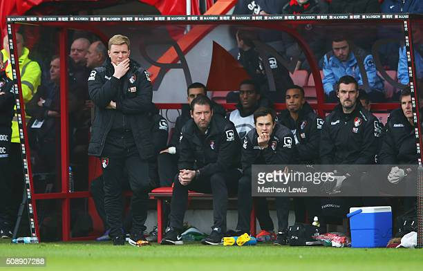 Eddie Howe manager of Bournemouth and the team bench look thoughtful during the Barclays Premier League match between AFC Bournemouth and Arsenal at...