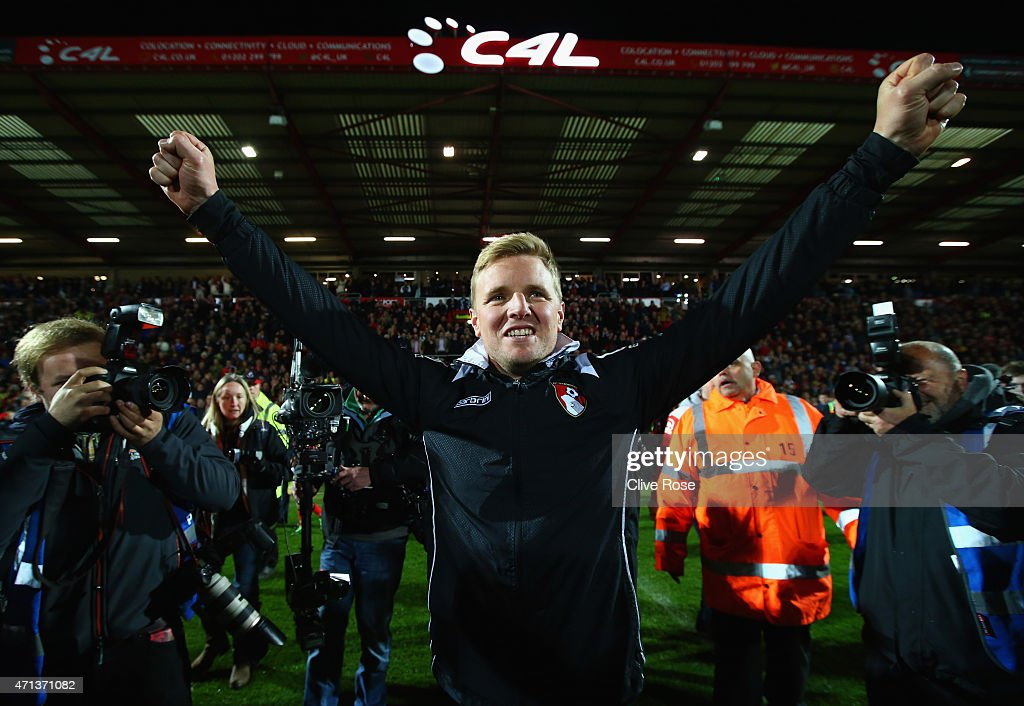 Eddie Howe manager of Bournemouth celebrates victory on the pitch after the Sky Bet Championship match between AFC Bournemouth and Bolton Wanderers at Goldsands Stadium on April 27, 2015 in Bournemouth, England. Bournemouth's 3-0 victory puts them on the brink of promotion to the Barclays Premier League.