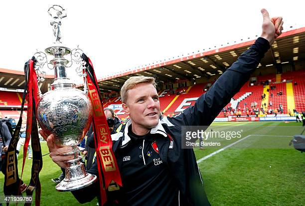 Eddie Howe manager of Bournemouth celebrates with the trophy after winning the Championship during the Sky Bet Championship match between Charlton...