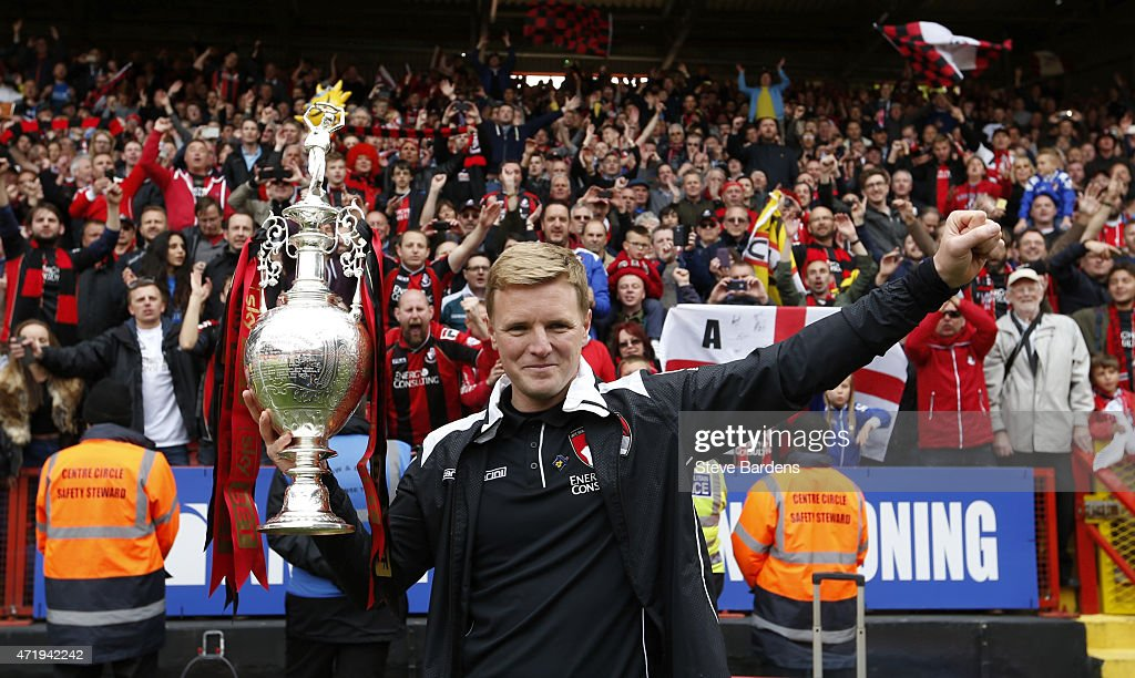 Eddie Howe, manager of Bournemouth poses with the trophy after winning the Championship during the Sky Bet Championship match between Charlton Athletic and AFC Bournemouth at The Valley on May 2, 2015 in London, England.