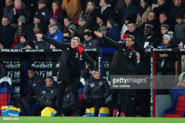 Eddie Howe manager of Bournemouth signals to his players next to his assistant Jason Tindall the fans after the Premier League match between Crystal...