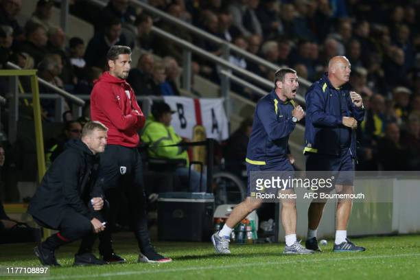 Eddie Howe of Bournemouth and Nigel Clough of Burton Albion during the Carabao Cup Third Round match between Burton Albion and AFC Bournemouth at...