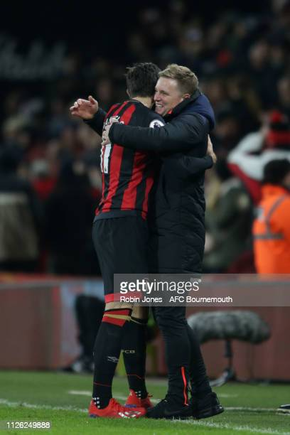 Eddie Howe of Bournemouth congratulates Charlie Daniels after he scores a goal to make it 4-0 during the Premier League match between AFC Bournemouth...