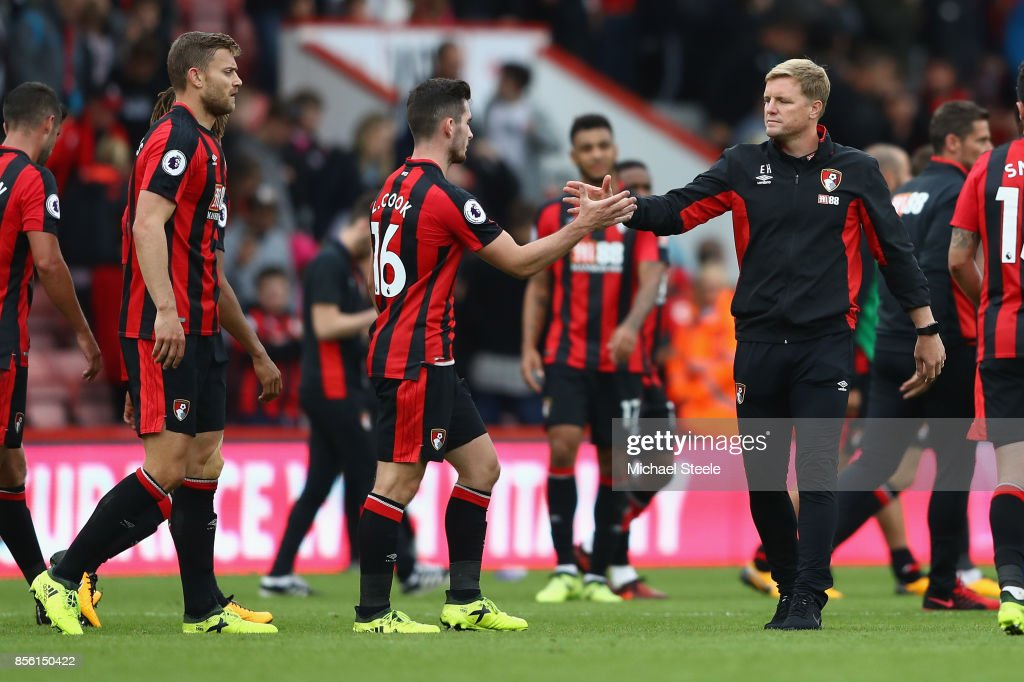 Eddie Howe (R) the manager of Bournemouth shakes hands with Lewis Cook after his side's 0-0 draw during the Premier League match between AFC Bournemouth and Leicester City at Vitality Stadium on September 30, 2017 in Bournemouth, England.