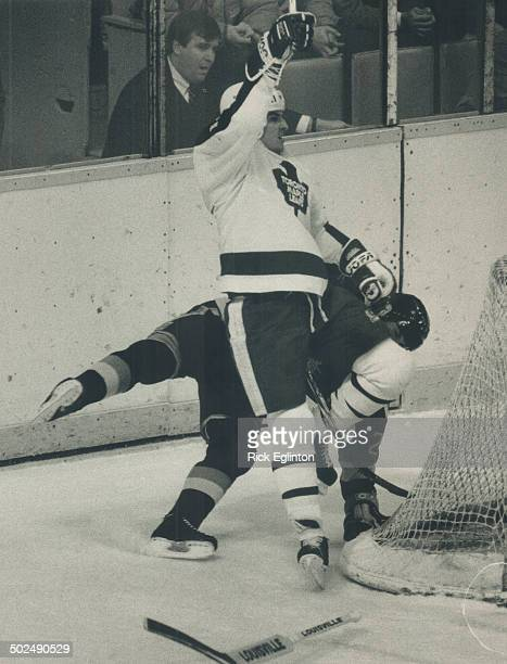Eddie in action The Leafs' Eddie Olczyk lowers the boom on Vancouver's Randy Boyd last night at the Gardens While not exactly billed as The Battle of...
