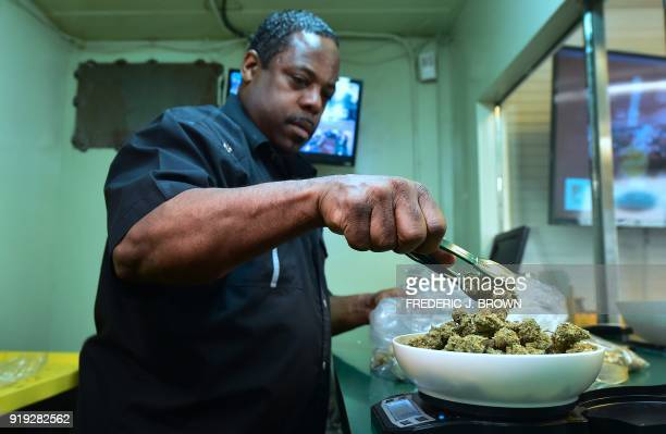 Eddie Irby weighs the marijuana at Virgil Grant's dispensary in Los Angeles California on February 8 2018 Virgil Grant is riding the high on...
