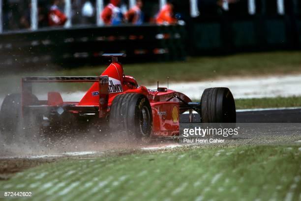 Eddie Irvine Ferrari F300 Grand Prix of Italy Autodromo Nazionale Monza 13 September 1998 Eddie Irvine running wide with his Ferrari F300 during the...