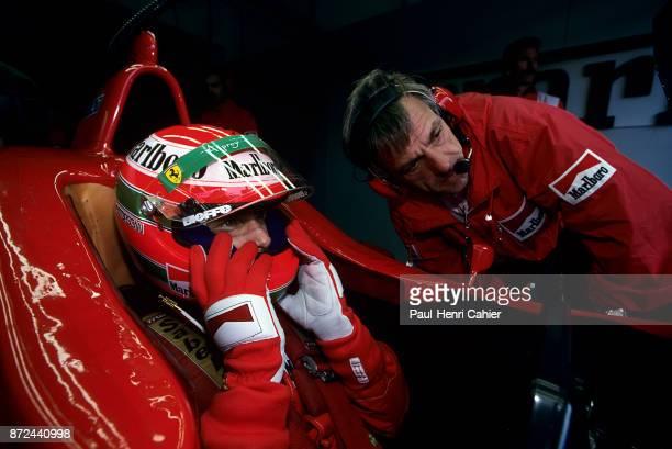Eddie Irvine Gustav Brunner Ferrari F310 Grand Prix of San Marino Autodromo Enzo e Dino Ferrari Imola 05 May 1996 Eddie Irvine with Ferrari engineer...