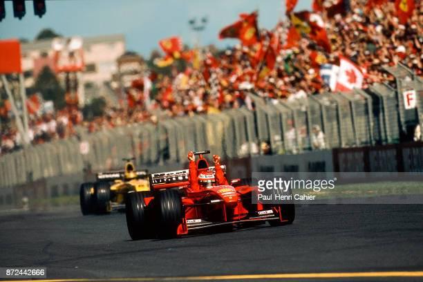 Eddie Irvine HeinzHarld Frentzen Ferrari F399 Grand Prix of Australia Albert Park Melbourne Grand Prix Circuit 07 March 1999 Eddie Irvineraises his...