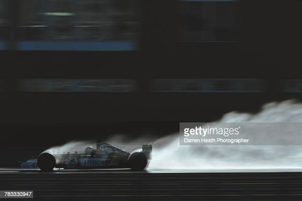 Eddie Irvine of Great Britain drives the Jaguar Racing F1 Team R3 Cosworth CR-3 in the wet during Formula One pre season testing on 10 January 2000...