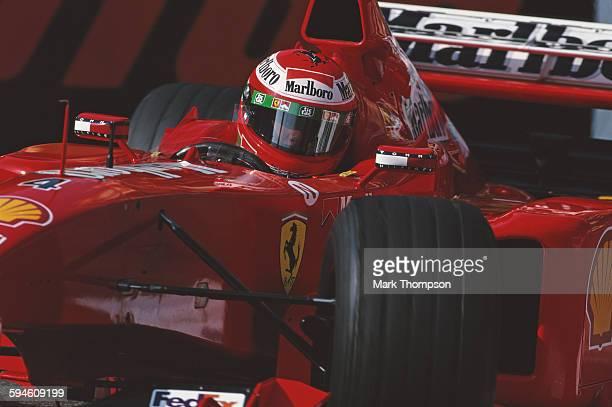 Eddie Irvine of Great Britain drives the Scuderia Ferrari Marlboro Ferrari F399 Ferrari 048 V10 during the Grand Prix of Monaco on 16 May 1999 on the...