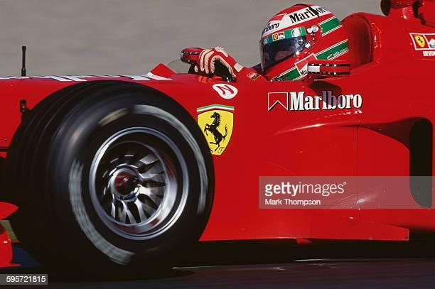 Eddie Irvine of Great Britain drives the Scuderia Ferrari Marlboro Ferrari F399 V10 during the Canadian Grand Prixon 13 June 1999 at the Montreal...